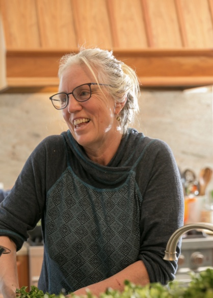 Jan Buhrman smiles while cooking