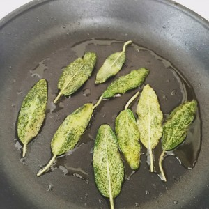 Crisping sage leaves in a skillet with oil