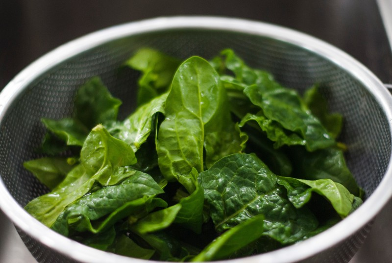 Spinach in a colander. Photo by Chiara Conti
