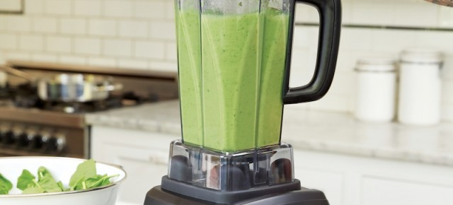 Green soup in a blender