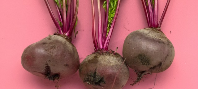 Three beets with stems attached